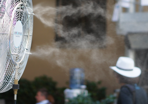 A fan with cooling spray.